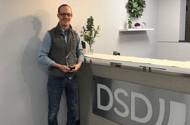 Erik Schiemann, CEO of DSD, holding the Verizon 2021 Supplier Sustainability Award.